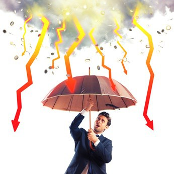 Businessman sheltered with umbrella from lightning arrow